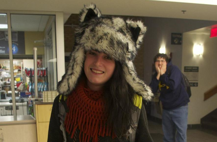 AACC student showing off her school spirit with wolf hat and a KickStart.