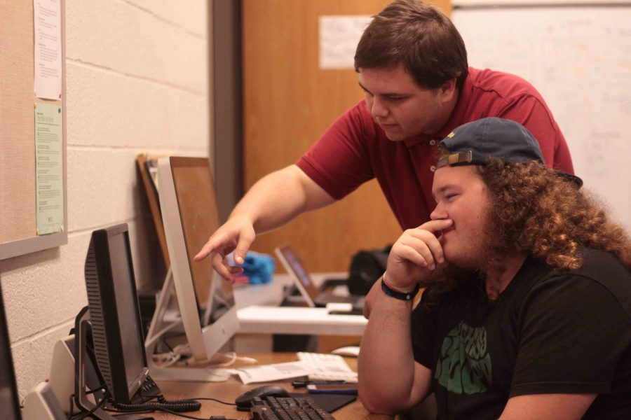 Editor-in-Chief Cody Colston (top) and Associate Editor Jesse Johnson (bottom) in action in the newsroom.