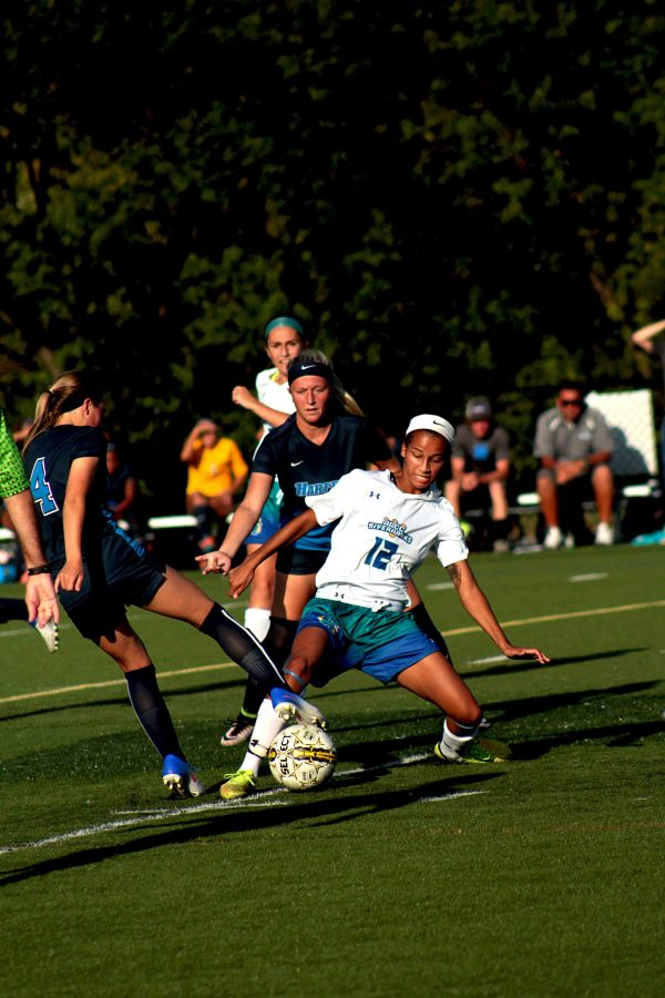 AACC+Women%E2%80%99s+Soccer+forward+and+co-captain+Bailey+Foust+reaches+out+to+take+the+ball+from+her+opponent.
