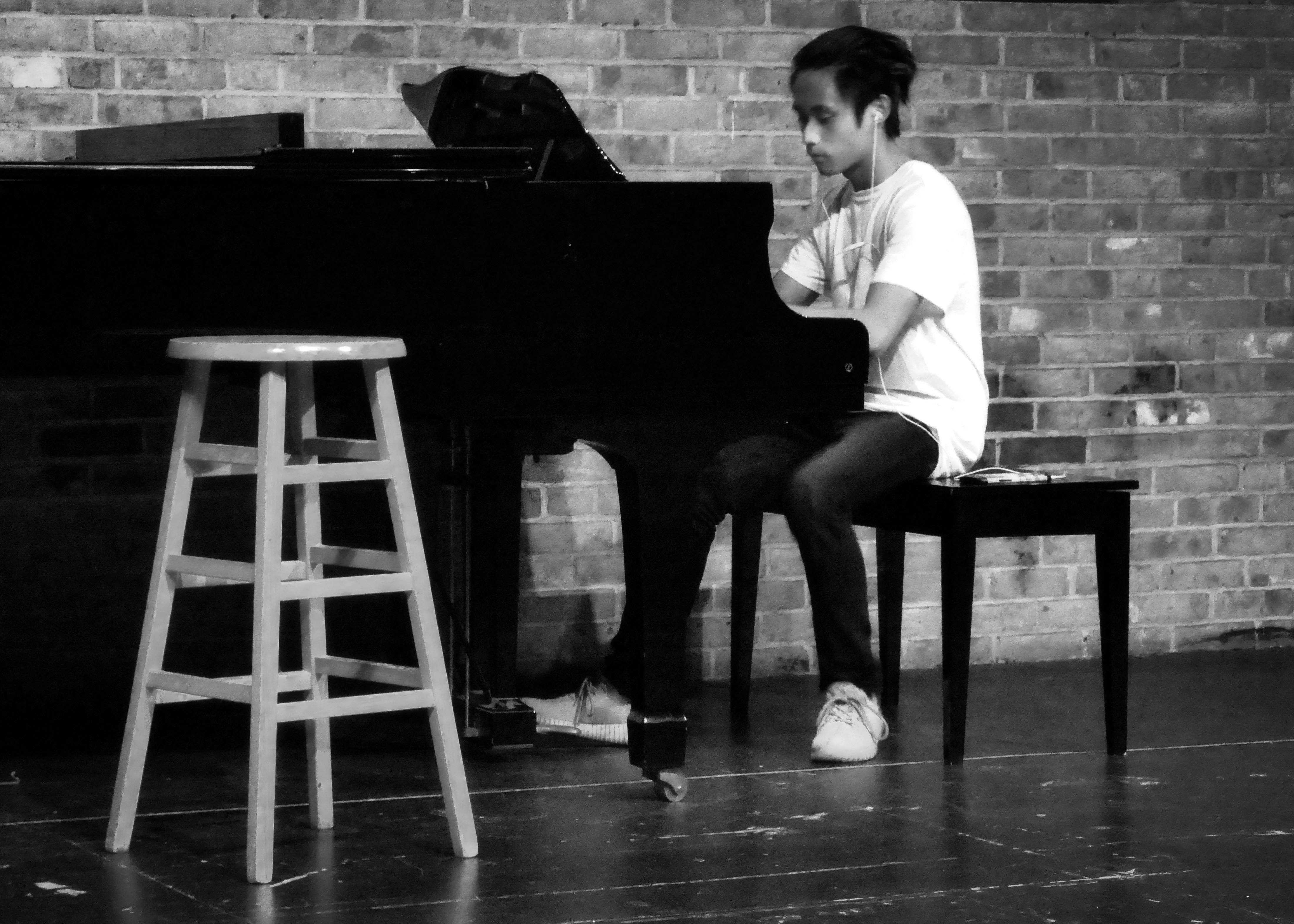 Austin Visk performs on the piano during October's Amaranth Coffee House.