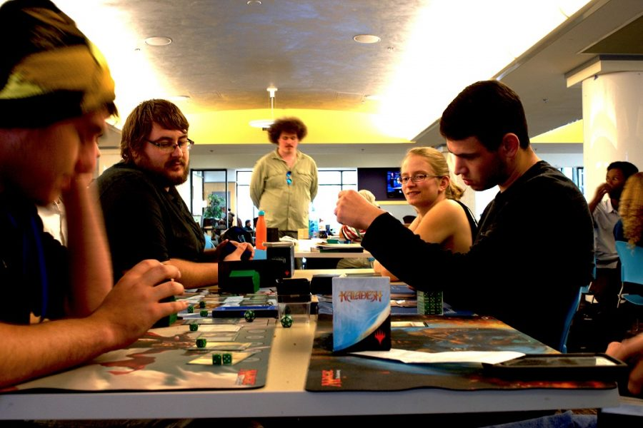 Students+gather+with+friends+in+the+Student+Union+building+to+play+the+fantasy-inspired+card+game%2C+Magic%3A+The+Gathering.