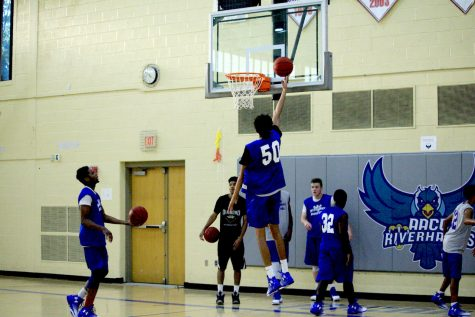 Men's basketball gets first win of the season