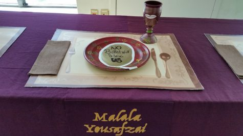 Sister Settings features visual art representing historic females through history. This place setting is from last year's display.