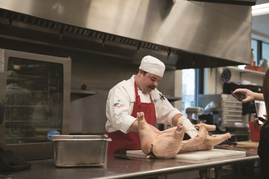 Culinary Institute butchers pig for demonstration