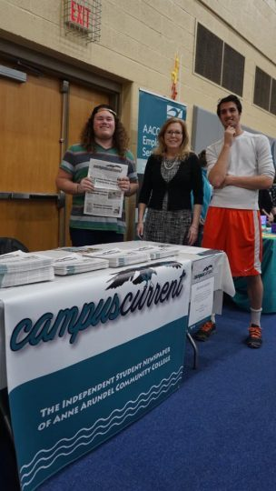 Campus Current staff awaits new recruits at this month's college fair
