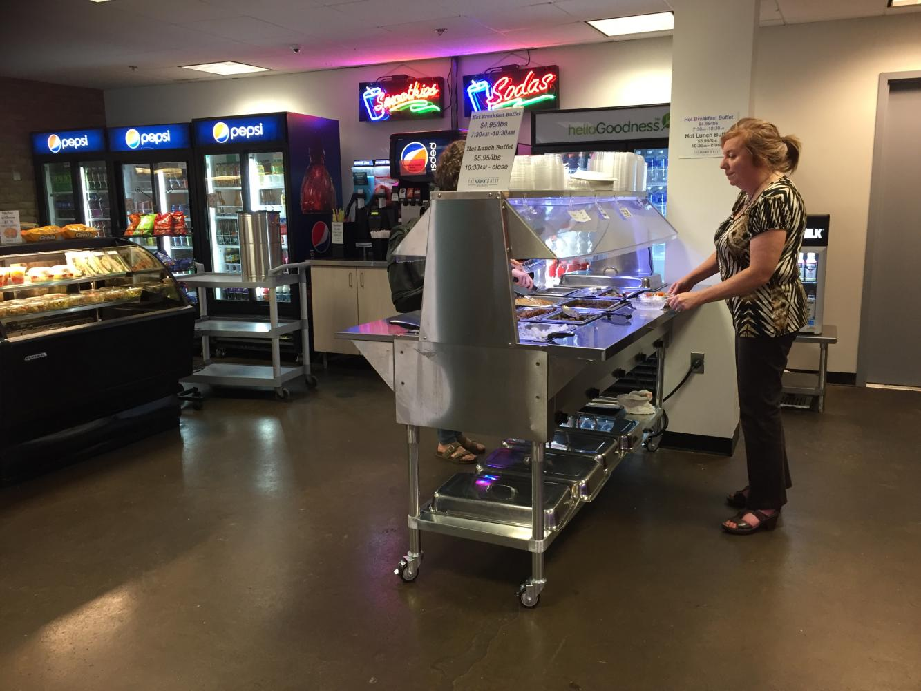 Diners are using the new hot food bar at the Hawk's Nest Grill & Deli.