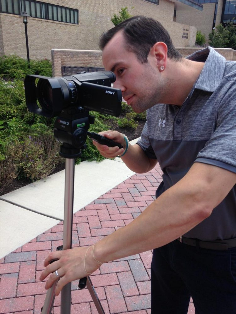 Sports information specialist Zach Malone tests the department's new camera
