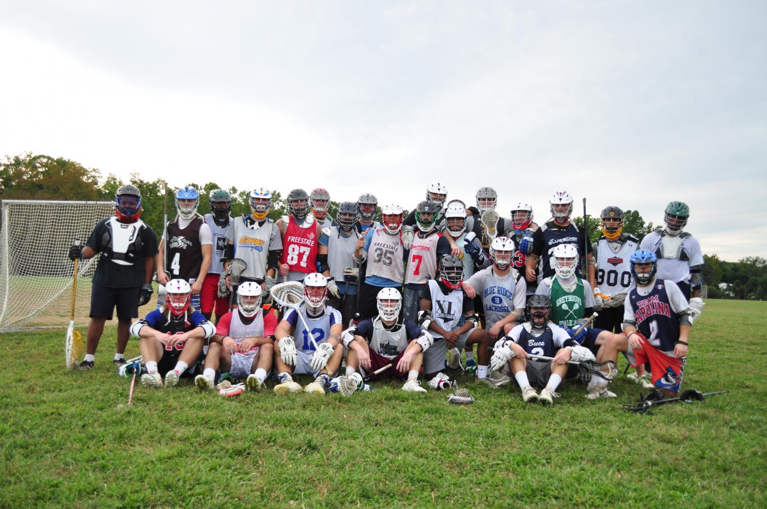 Men's Lacrosse players pose after a fall ball practice session, months before their regular season.
