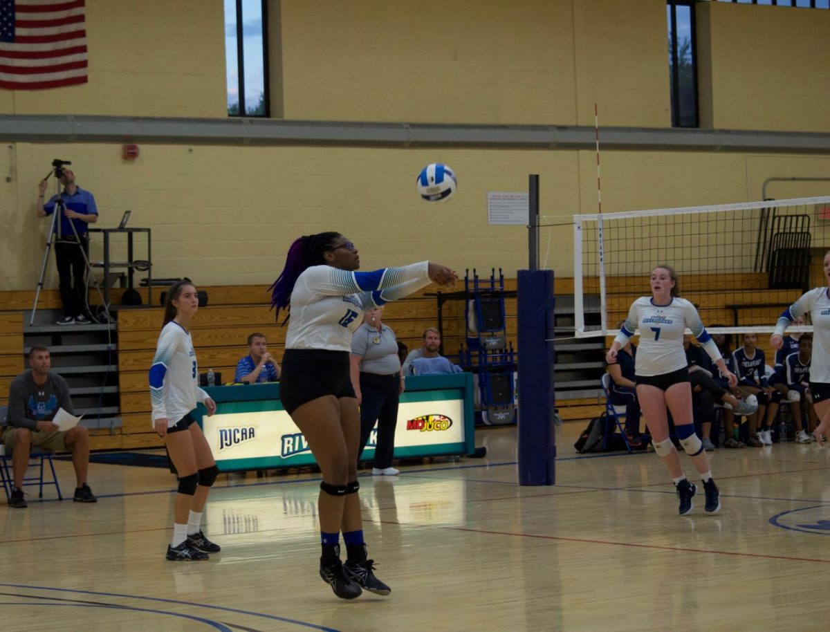 Carly Bohlen (left), Cailin Jones and Brighde Williamson play against the Chesapeake Shipjacks on Sept. 12.