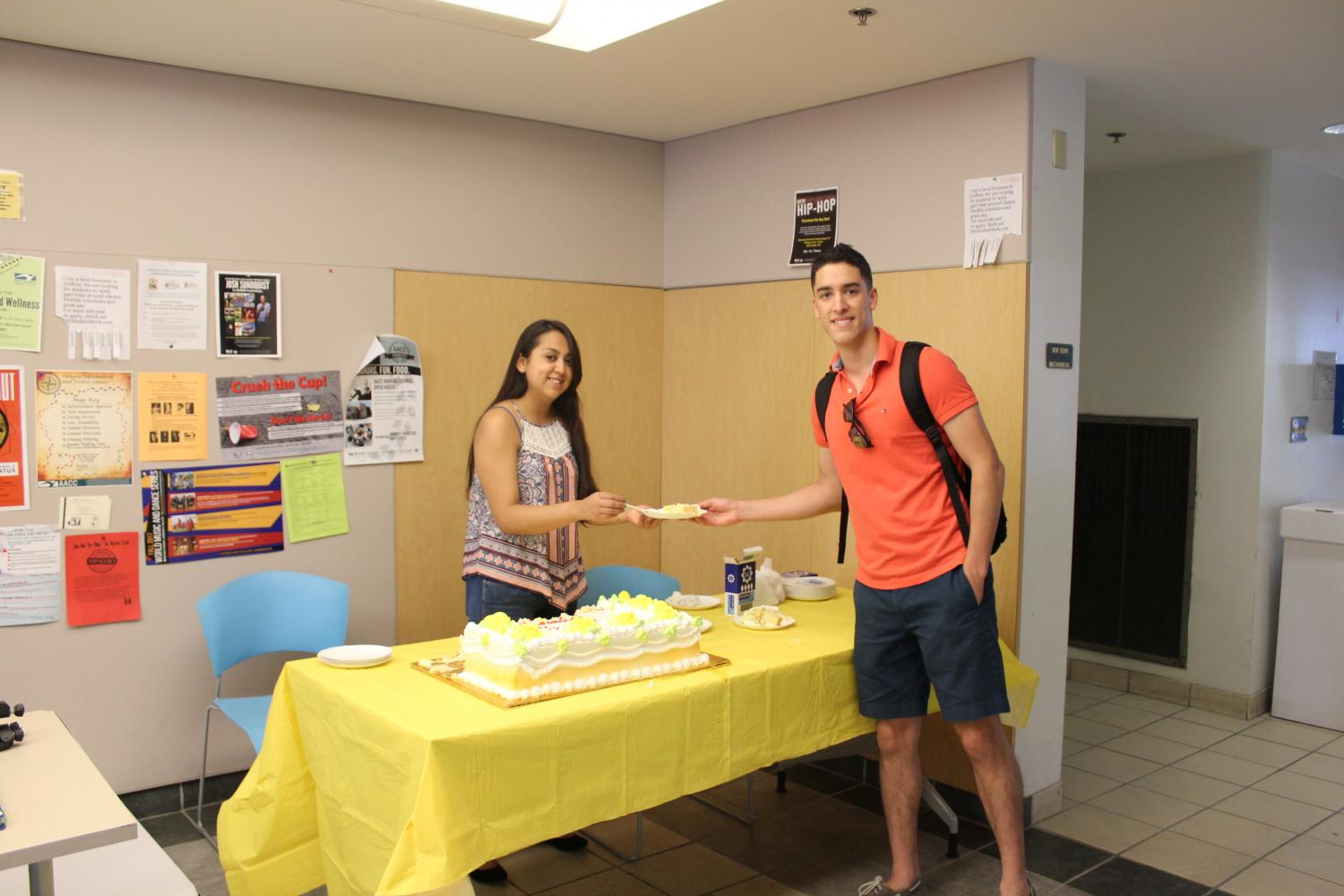 Diana Perez, president of Latino Club, is handing out tres leches cake in honor of Hispanic Heritage month.