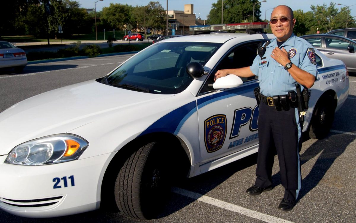 AACC Police Officer Dung Do pauses during a routine patrol of the campus. Do relocated from Vietnam to Maryland after serving in the Vietnam war.