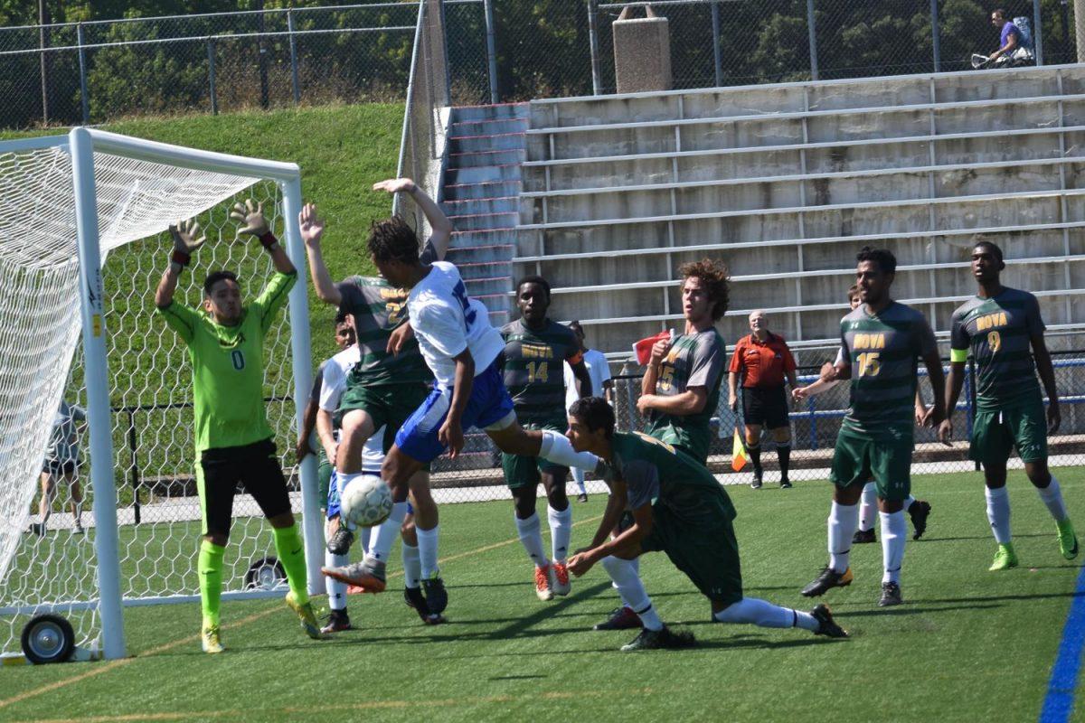 Keityn Pruett (center) scores a goal during a Men's Soccer game against NOVA Community College.
