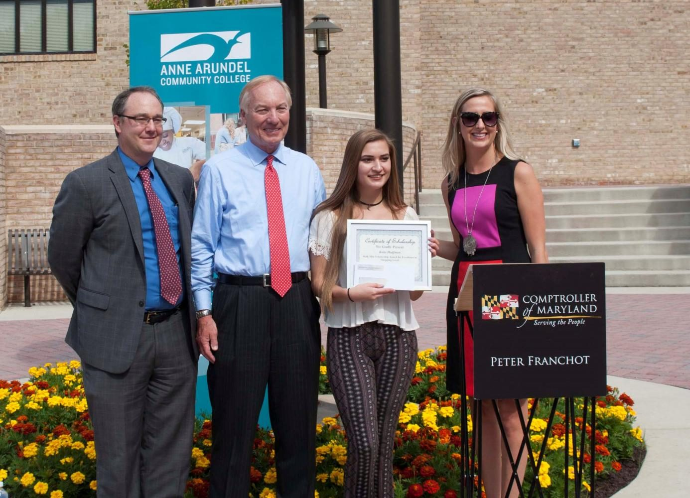 Dr. Mike Gavin, Vice President of Learning (left); Comptroller Peter Franchot; student winner Katie Huffman; and Cailey Locklair Tolle, president of the Maryland Retailers Association. Photo courtesy of Myles Gadsden, AACC Public Relations and Marketing Department.