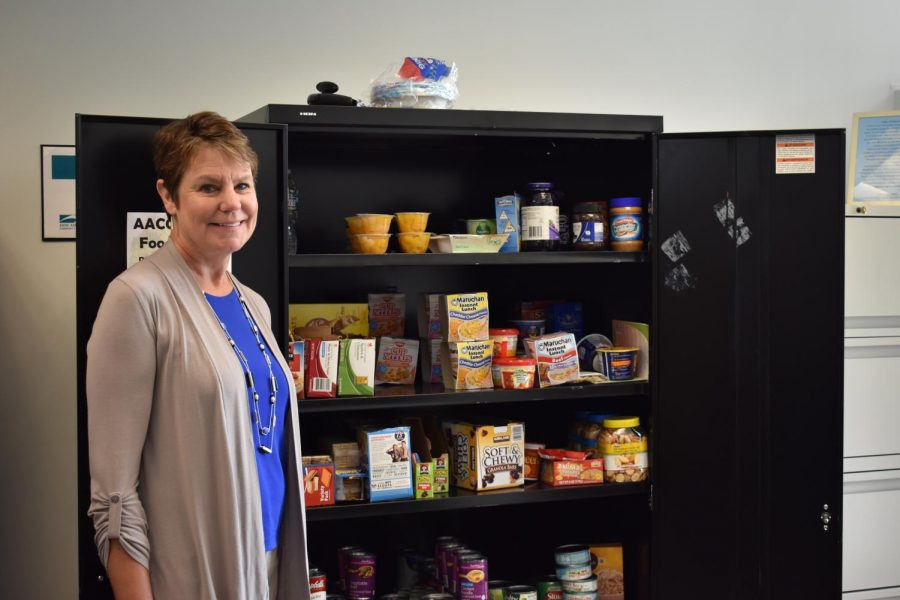 Director+of+Student+Engagement+Chris+Storck+stands+beside+the+food+pantry+in+her+office%3B+the+pantry+offers+food+to+students+who+can%E2%80%99t+afford+meals.