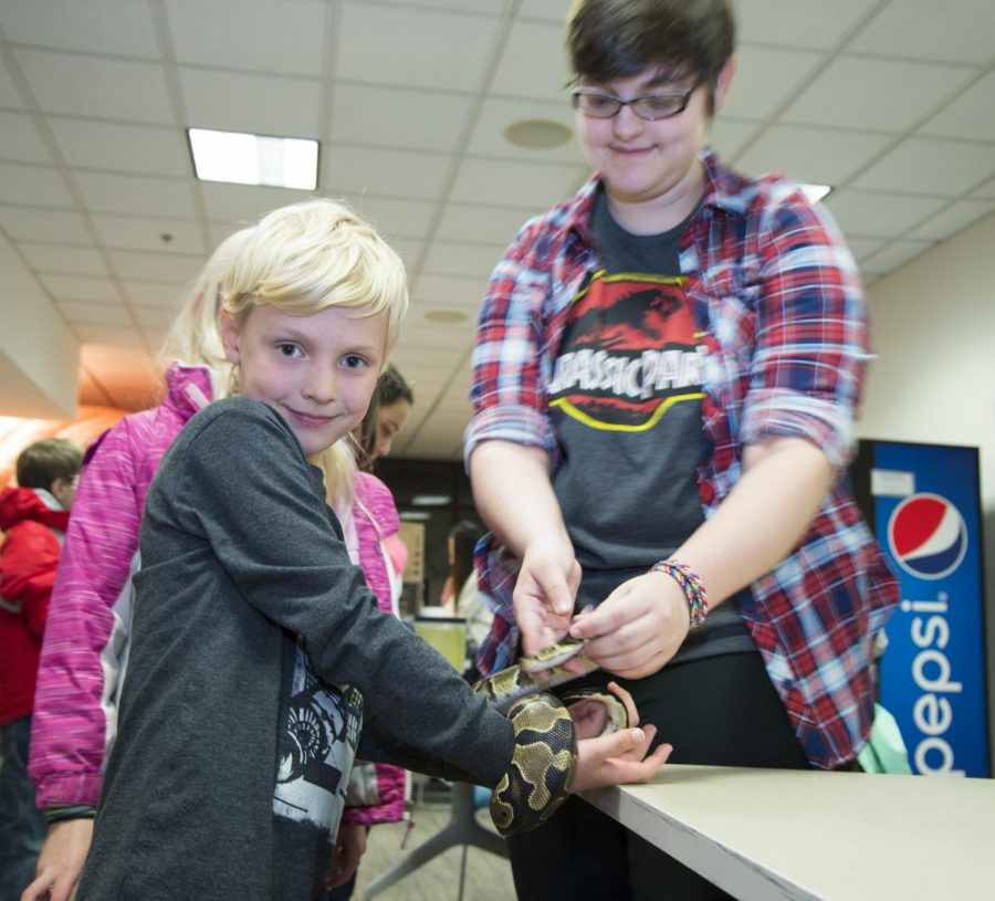 Participants encounter insects and reptiles such as snakes, cockroaches and earthworms up-close and personal during AACC's annual Science Night.