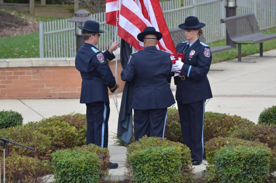 AACC's Color Guard raises the U.S. flag during a Veterans Day ceremony, held on Nov. 9.