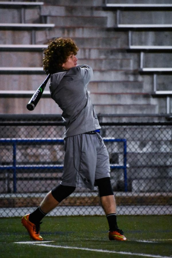 First-year student athlete Noah Ratsy swings during practice. Photo by Raquel Hamner