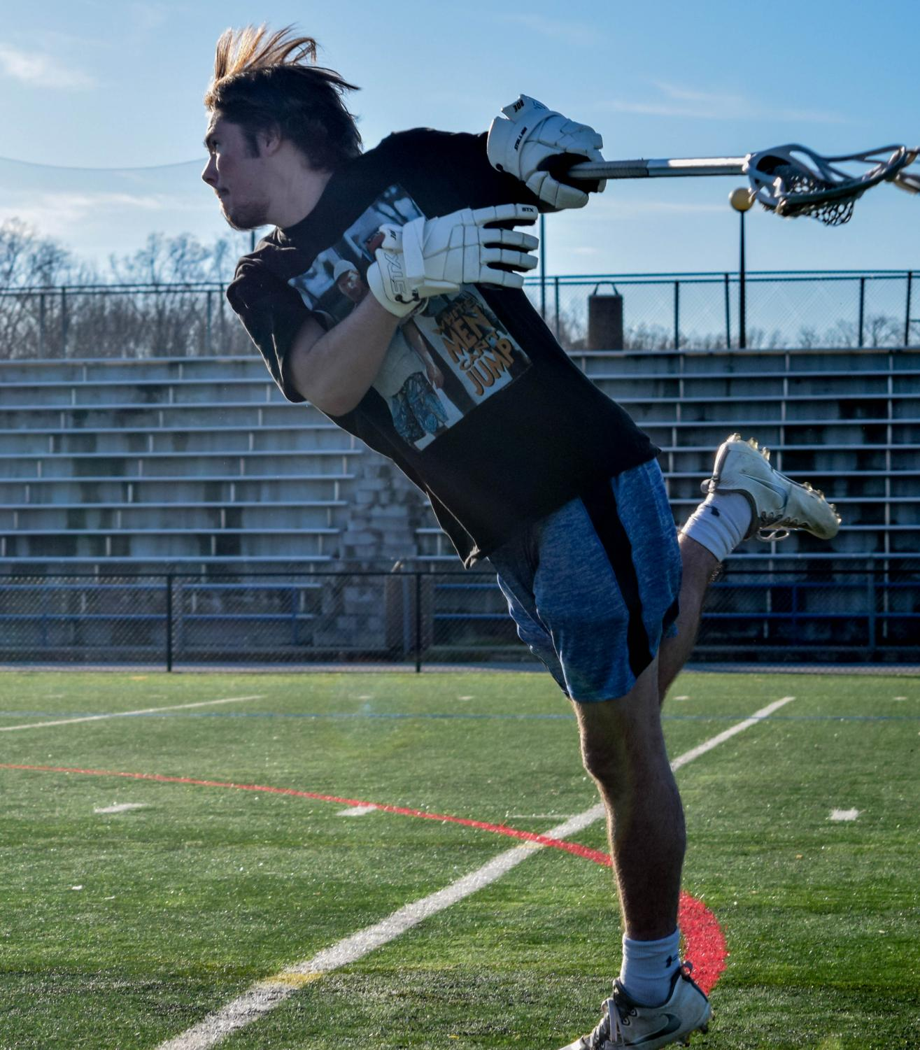 Lacrosse player Noah Reem shoots during practice. Photo by Raquel Hamner