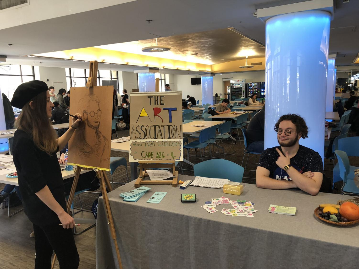 Kat Pfeiffer, a second year art student, and Chris Lins, the president of the Art Association, promoted their club at the Student Involvement Fair on Jan. 31.