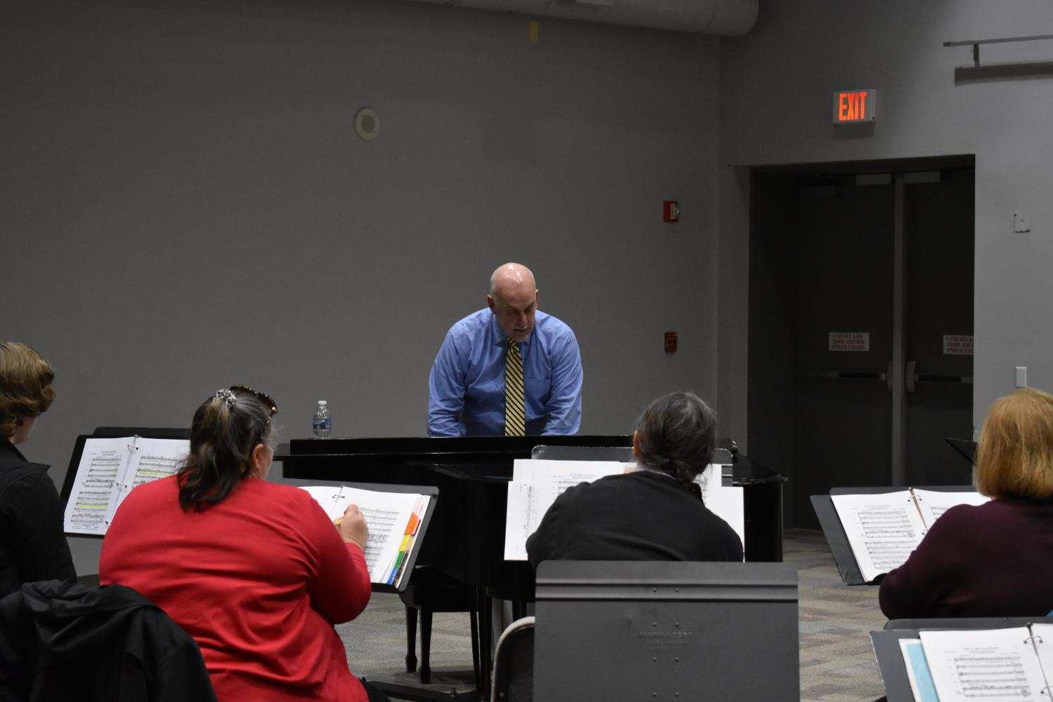Performing Arts Chair Doug Byerly and the choir rehearse for a concert tour of Spain. Photo by Daniel Salomon
