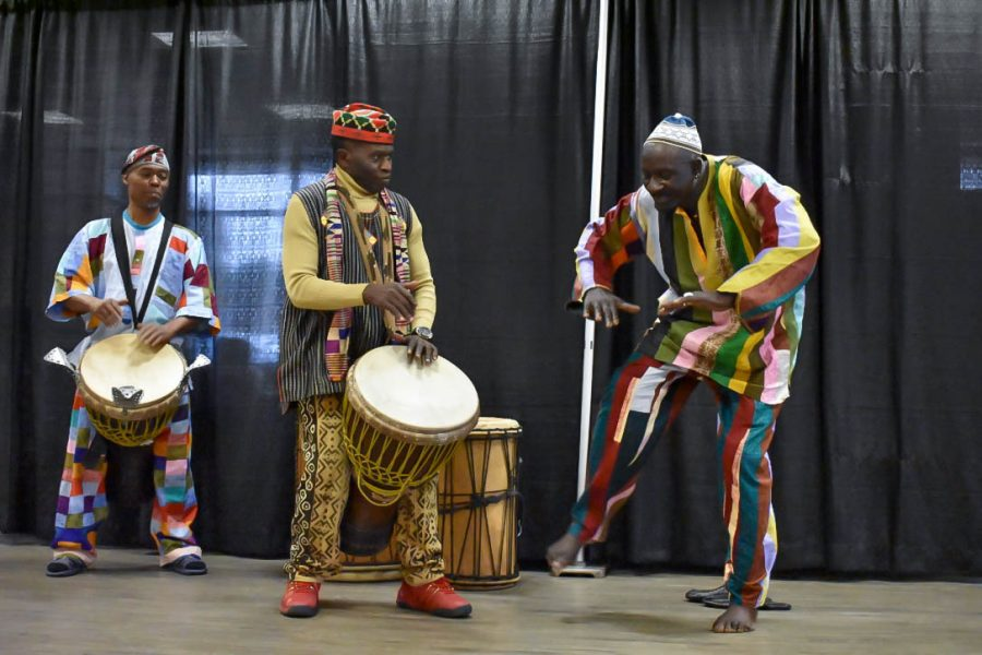 KanKouran+performers+teach+participants+how+to+play+traditional+African+drums.