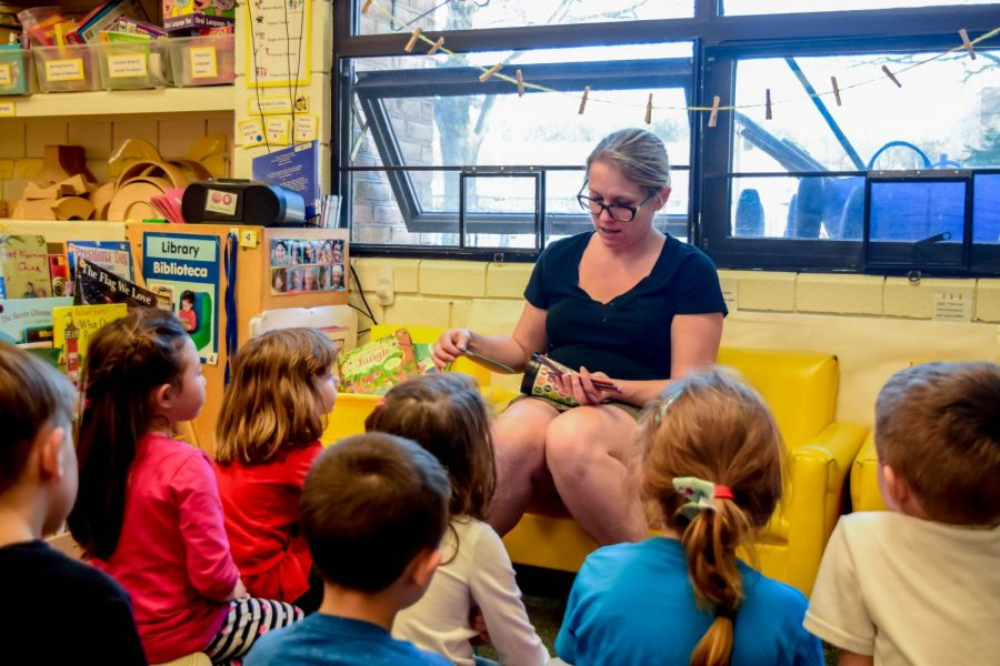 Wendy Milasi, a teacher at AACC's Child Development Center, works with children. The Student Education Association also works with the CDC children.