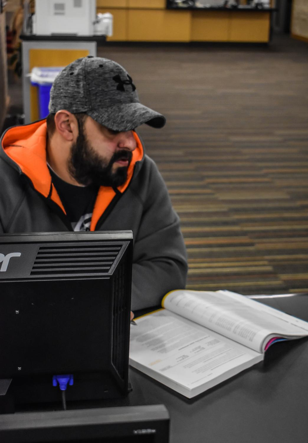 First-year transfer studies student Rooz Inanloo reads in the library. Photo by Daniel Salomon