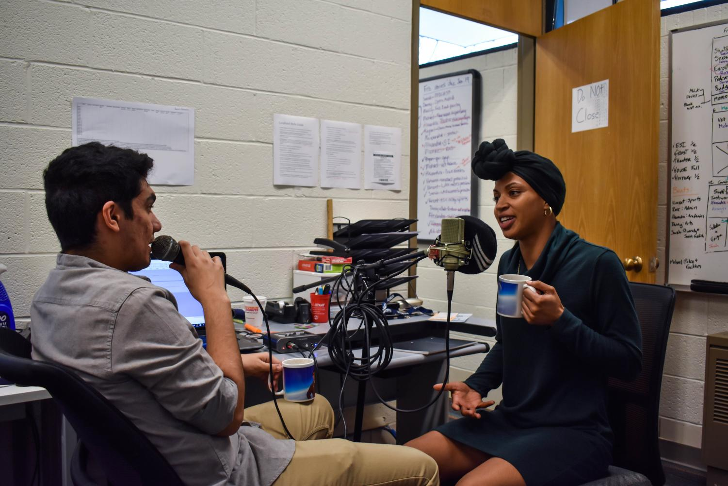 "Campus Current digital editor Daniel Salomon interviews student trustee Nyia Curtis for the new podcast, ""Riverhawk Report."" Photo by Sarah Noble"