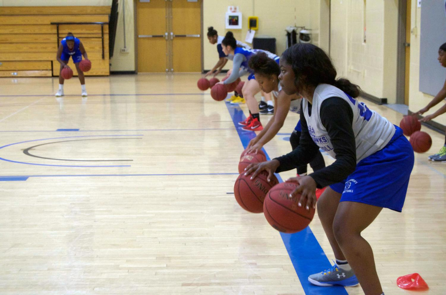 Women's Basketball players practice for a game together before the season ends.