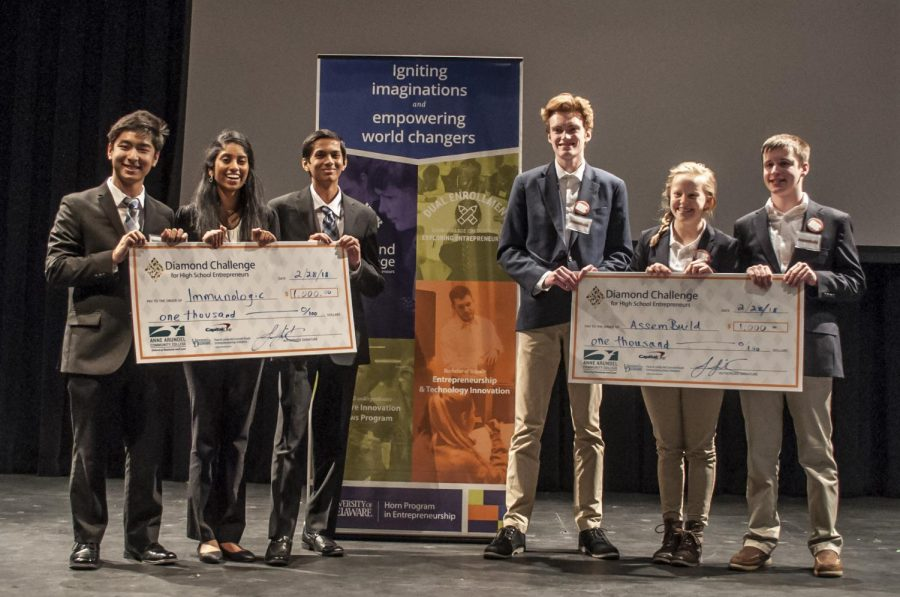 Immunologic Computing (right)—high school juniors Andrew Yu, Yashas Salankimatt and Shobha Dasari—and AssemBuild—junior Clare Hudak and seniors Matthew Lynerd and Collin Griffin—pose after winning the Diamond Challenge live pitch round at AACC.