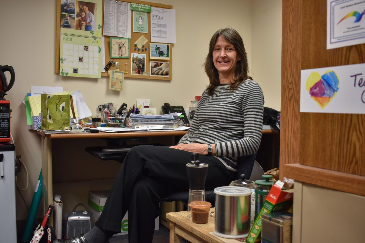Nutrition professor Karen Israel has filled her office with items she has found a second use for, like Mason jars, plastic silverware and paper products.