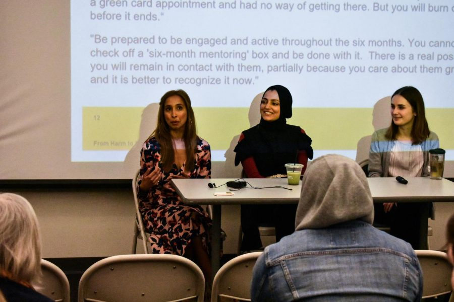 Maheem Taqui (left) and Nimra Kham give a lecture in CALT 100 at an immigration information session.
