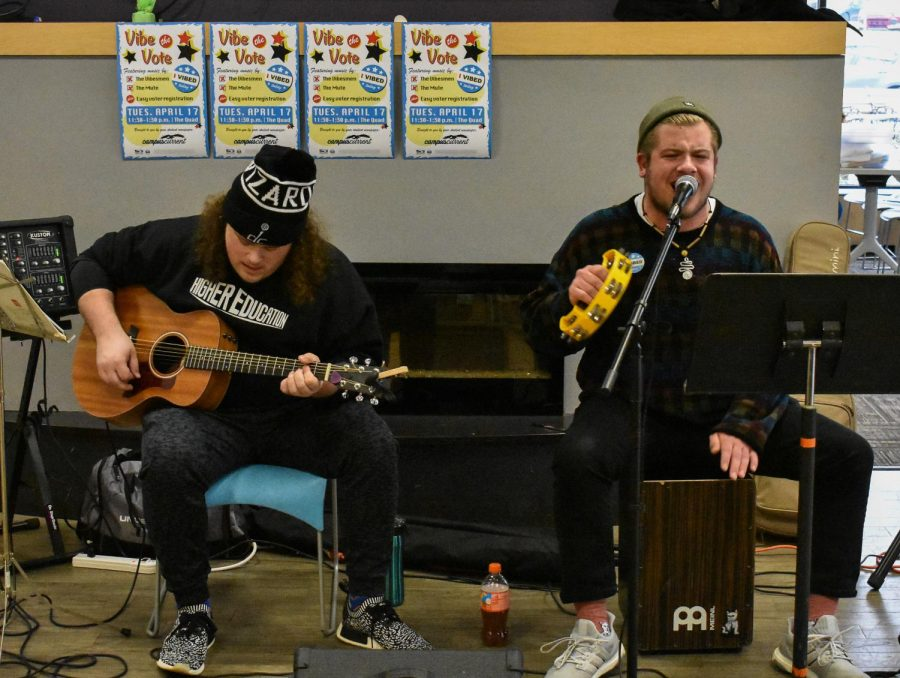 The Vibesmen's guitarist Jesse Johnson (left) and vocalist Nick DiPietro play at Vibe the Vote in the SUN dining hall on April 17.
