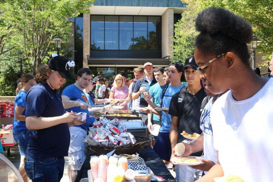 Student line up for free food during CAB's cookout on the Quad.