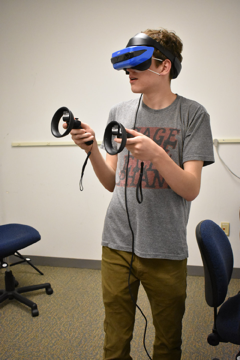 AACC's Campus Current Tech Editor Alex Fregger tries out a virtual reality headset for the first time in the college's VR room in the CALT Building.