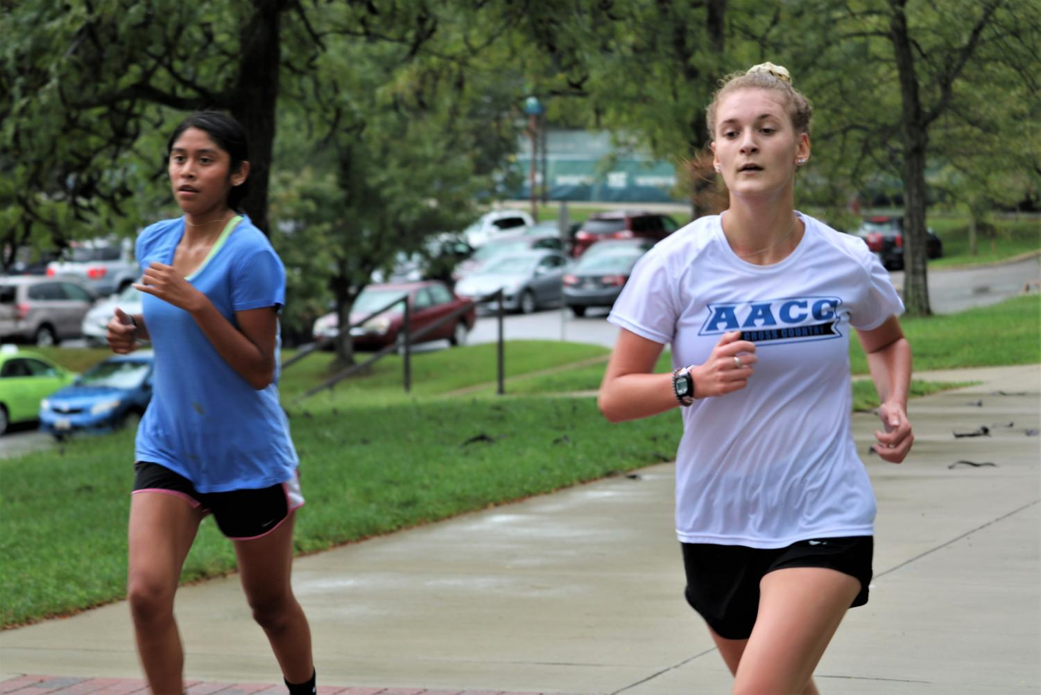 Cross Country runners Leslei Garcia Mendez, left, and Emily Jacobsen keep in shape by running on campus.