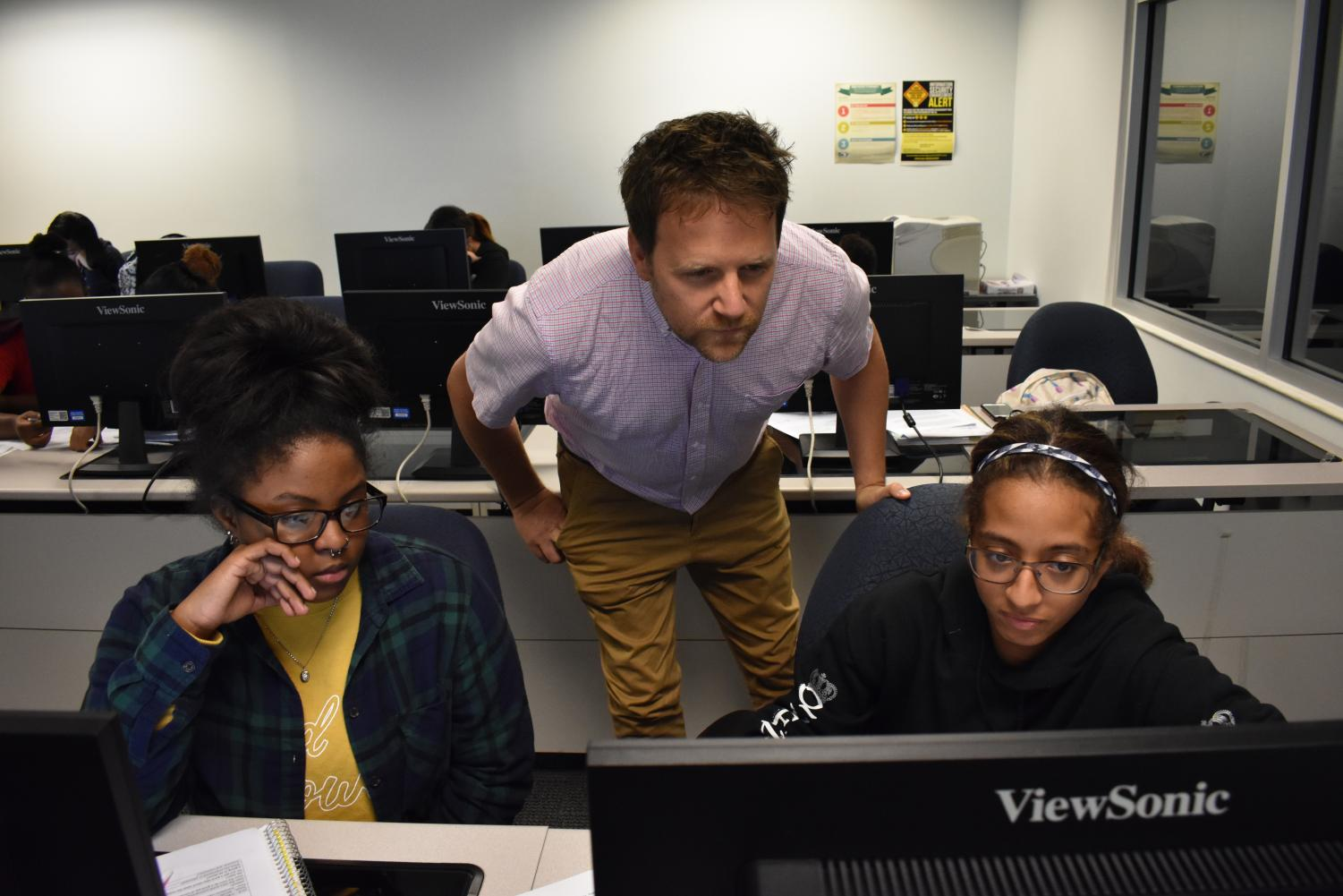 Professor Forrest Caskey teaches first-year interior design student Jalaya Stevens (left), and first-year physical therapy student Mariah Melendez.