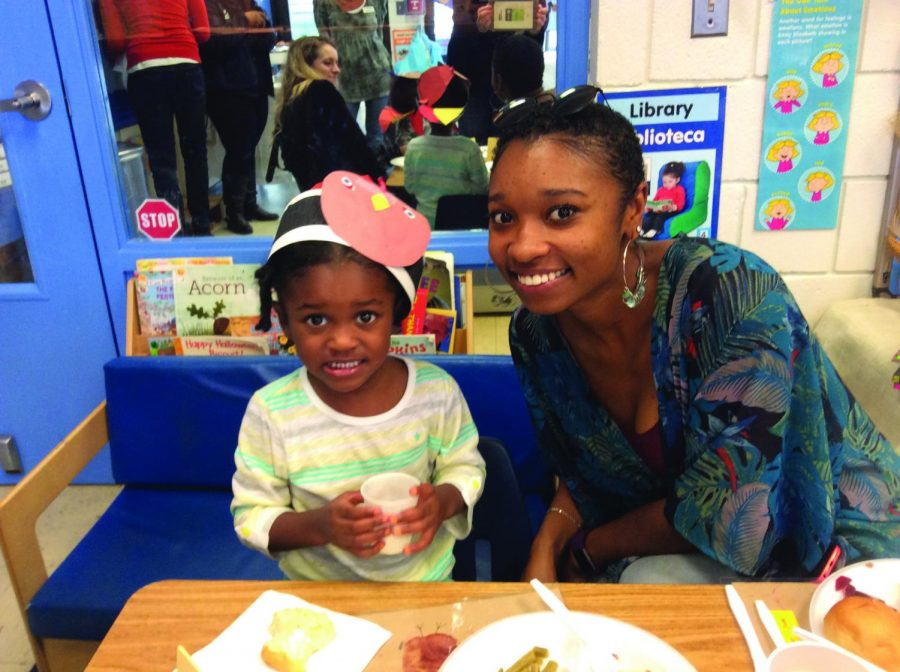 AACC student and mom Morgan Mitchell attends a Thanksgiving luncheon with her daughter Jade at the Child Development Center, which will offer free evening care next semester.