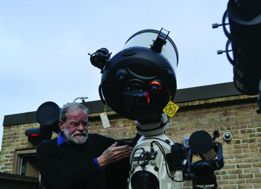 Professor Tom Wilbur sets up one of six telescopes AACC owns as part of the Observatory.