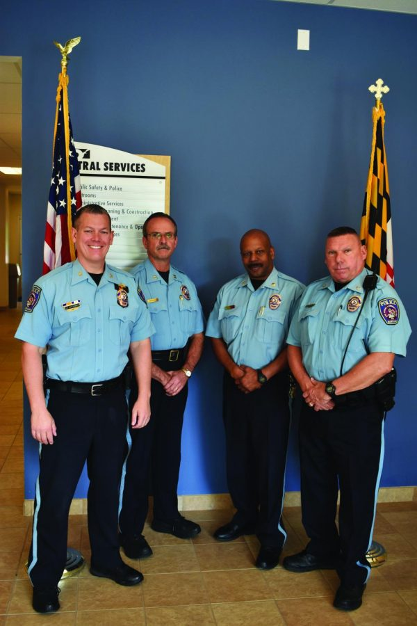 Police Chief Sean Kapfhammer (left) poses with three of the four former SWAT officers who work at AACC: Capt. Dave Pressley, Maj. Cleveland Smith and Officer Don Medtart.