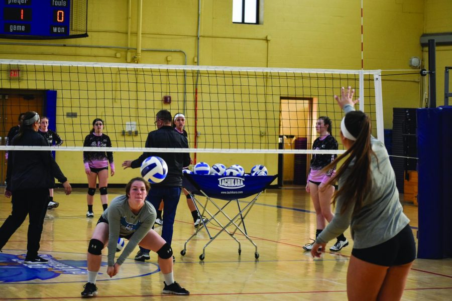 Women's Volleyball middle hitter Deanna Valerian (left) and outside hitter Brittney Guy practice before their last games.