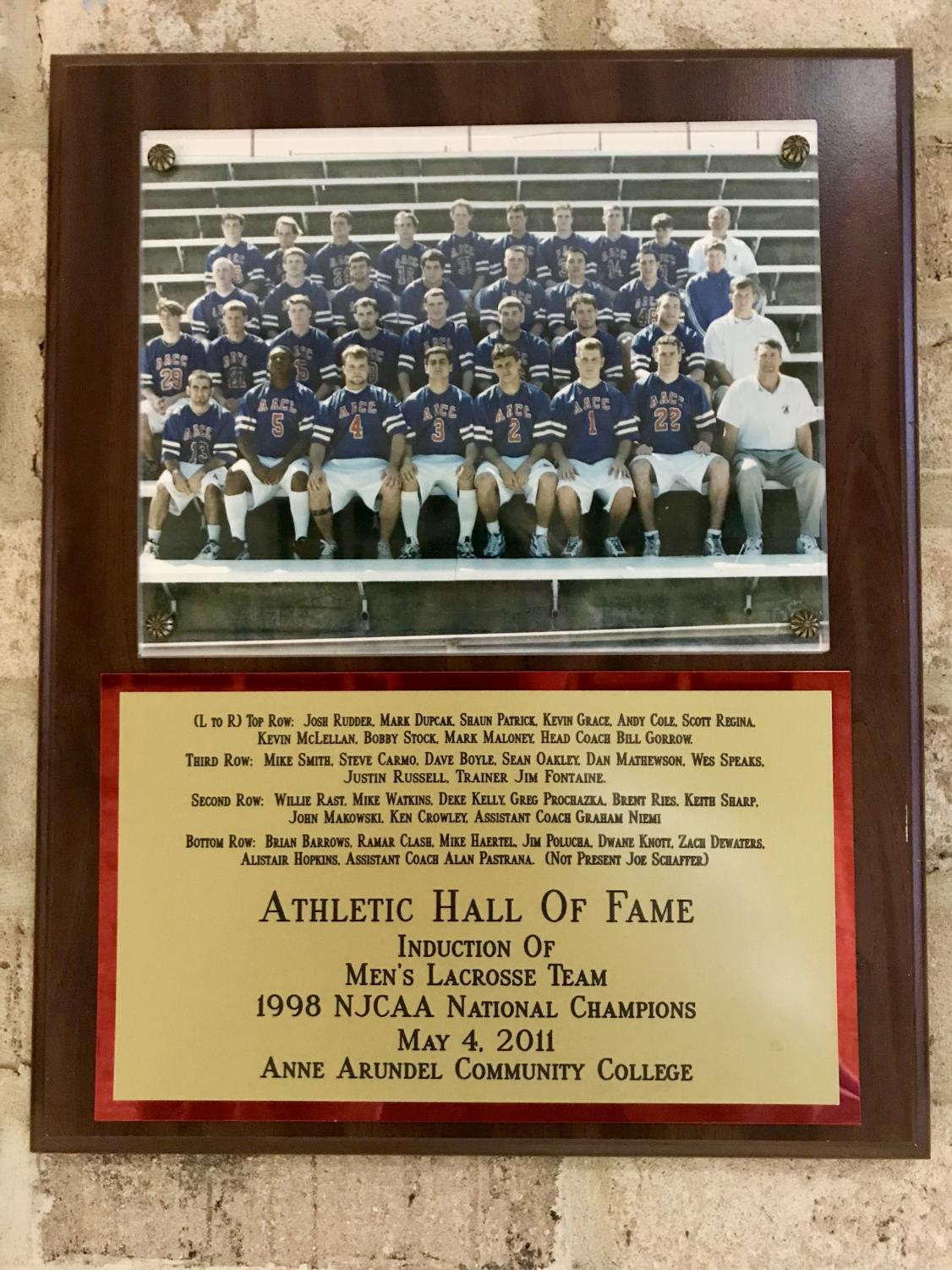 The team plaque hangs  in the AACC Hall of Fame in the gym.