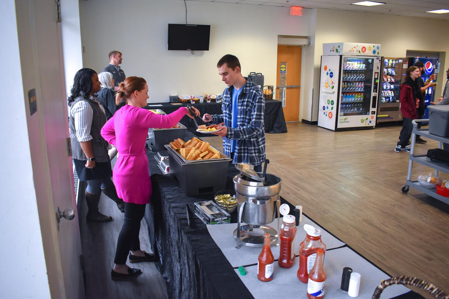 Timothy Aquilino, 4th year fine arts student, gets a plate of hot food filled from the free breakfast event.