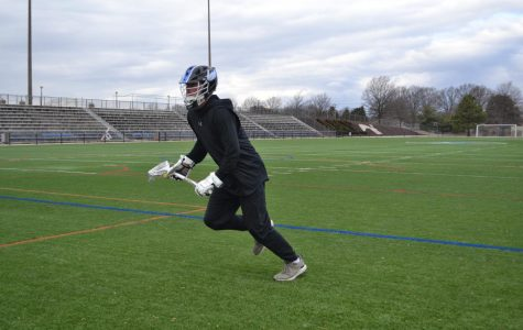 Second-year communications student Noah Reem, midfielder, prepares for the lacrosse season by working out on the turf. The team opens the season at home on Feb. 23.