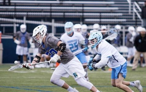 All-American lacrosse player Nick Karnes wins a face-off against Onondaga Community College last season. Karnes will not return to AACC in 2019.