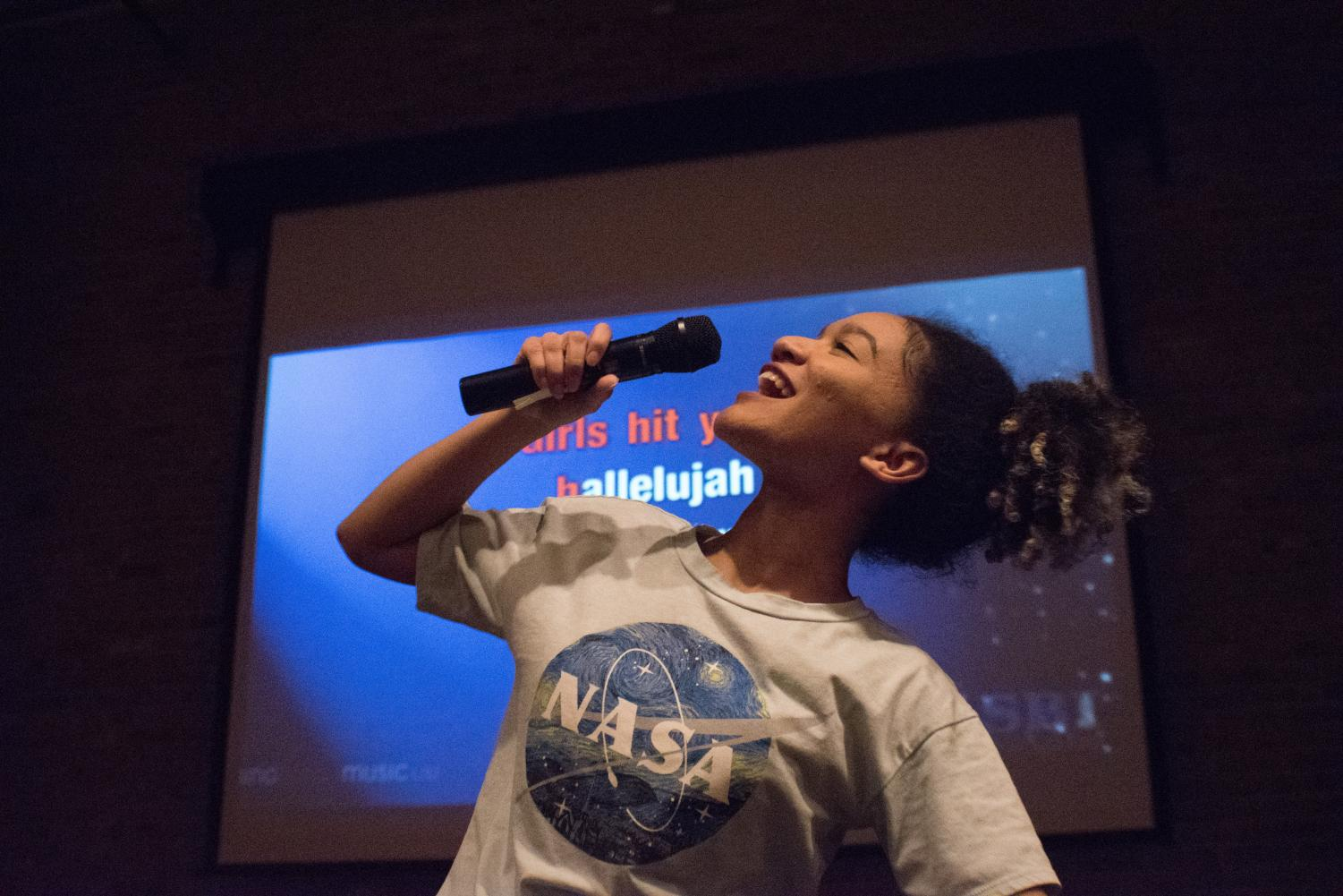 Former Campus Current photo editor Raquel Hamner belts out a song while practicing with friends for an upcoming karaoke outing. AACC will host karaoke events this semester.