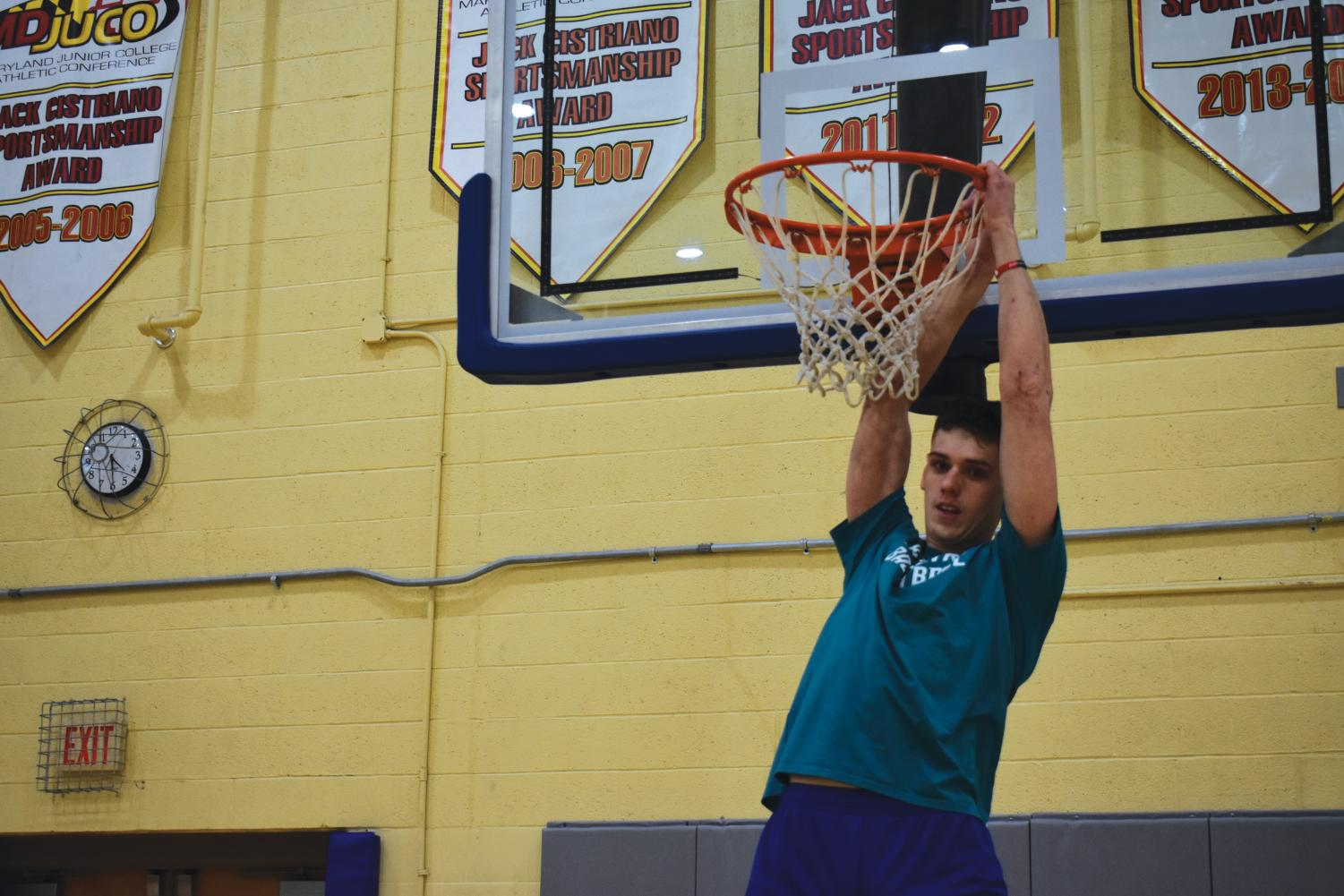 Jacoby Rojas, power forward on Men's Basketball, warms up. AACC is adding a basketball course.