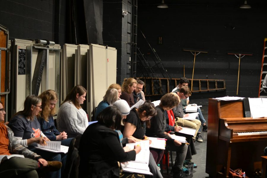 """""""Sweeney Todd"""" performers look over sheet music."""