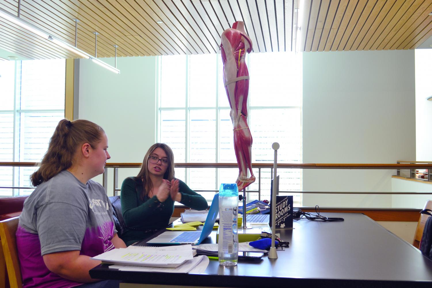 Allison Kral, a first-year phlebotomy student, and Hannah King, a first-year nursing student, took advantage of campus resources by borrowing a model of a leg.