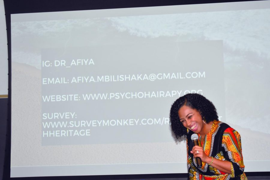 Psychologist+Afiya+Mbilishaka+styles+clients%E2%80%99+hair+while+she+counsels+them.